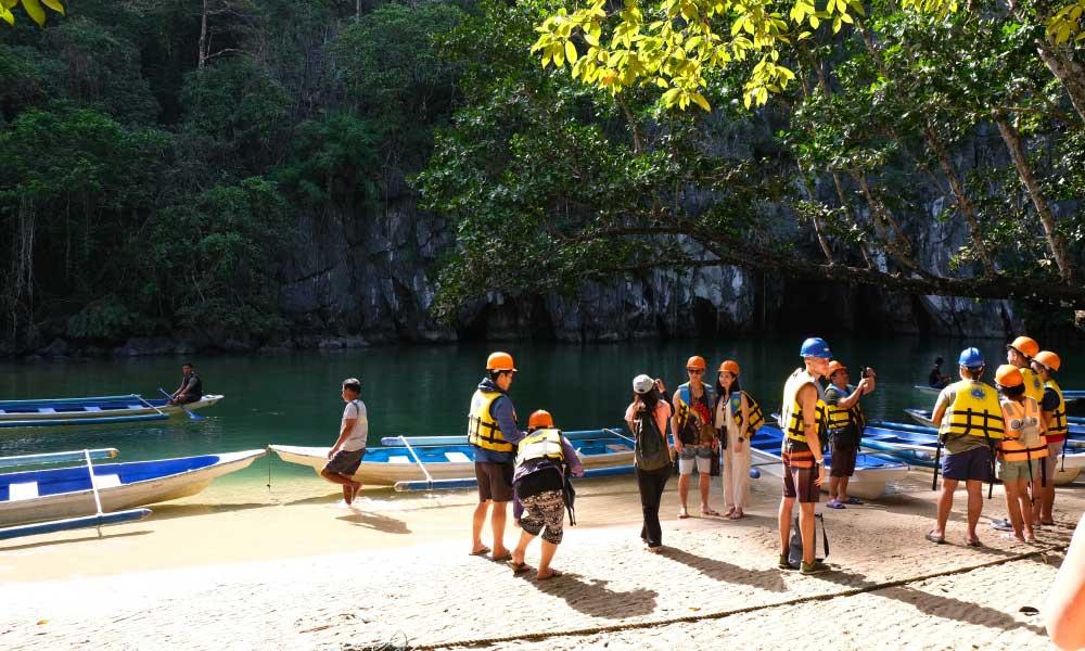 Shows a group of tourists at Puerto Princesa Underground River