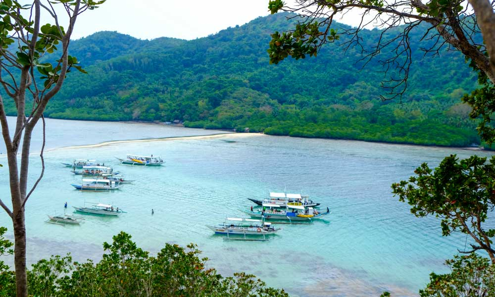 Where to stay in El Nido - Shows boats floating by a sand bar