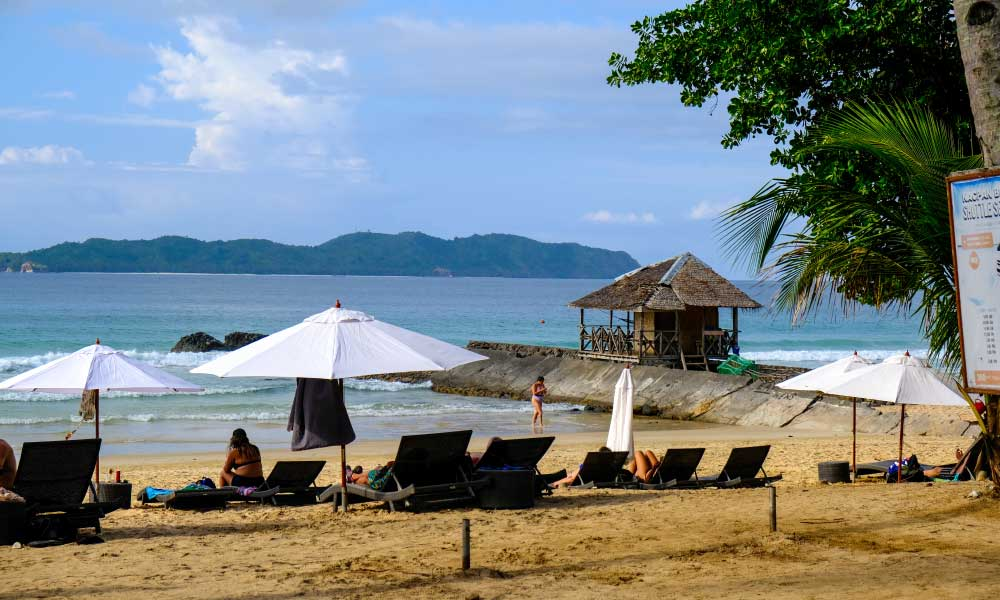 Things to do at Nacpan Beach - Shows sun loungers on the beach