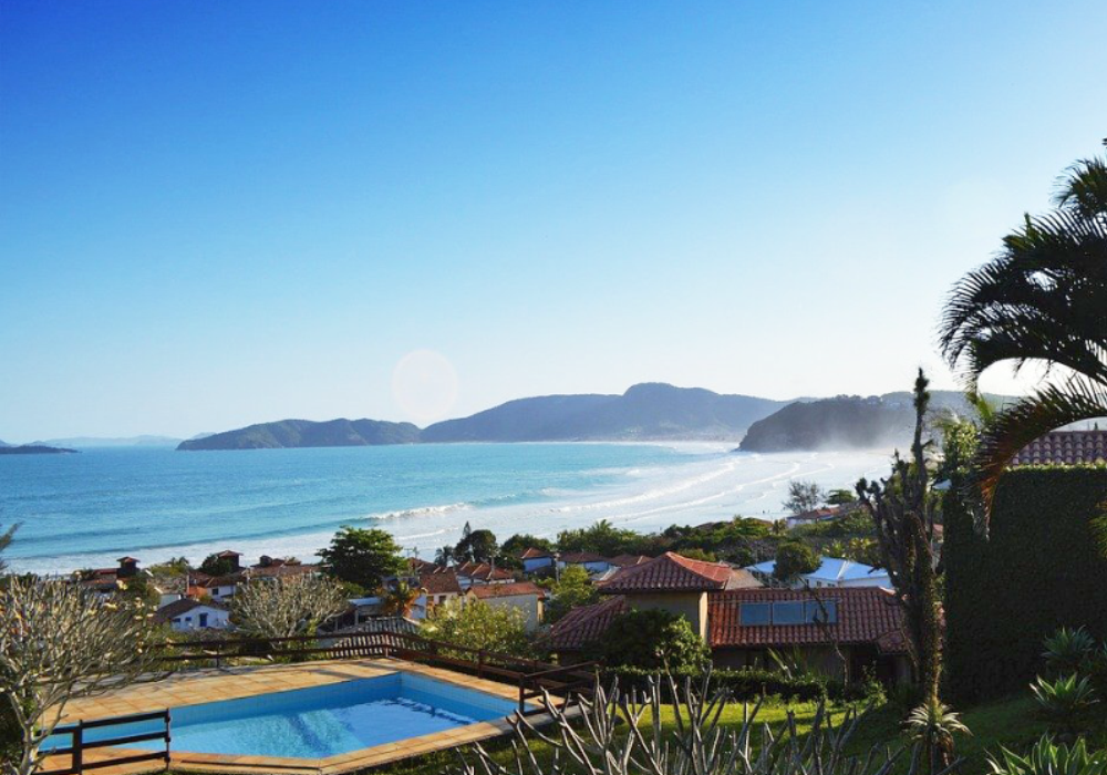 Where to go in Brazil - Shows a swimming pool overlooking a beautiful bay in Buzios