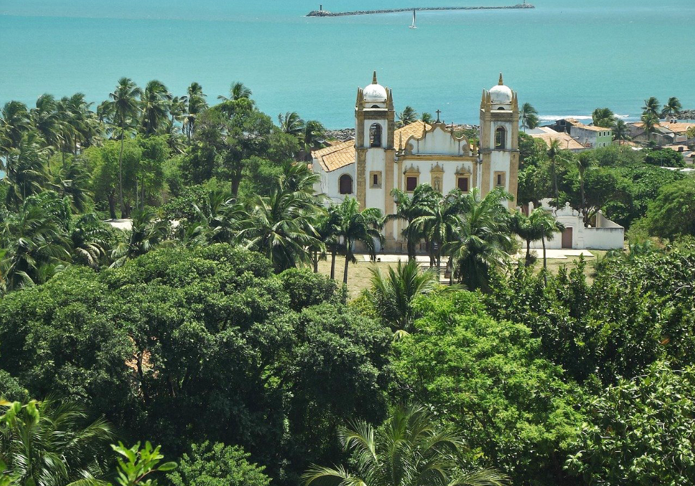 Shows Olinda town amongst a forest - Best places to visit in Brazil