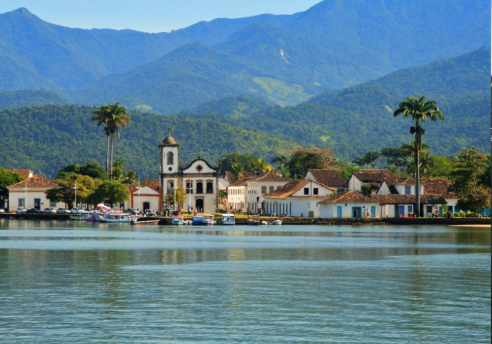 Shows Paraty town buildings and mountains in the distance - Best places to visit in Brazil