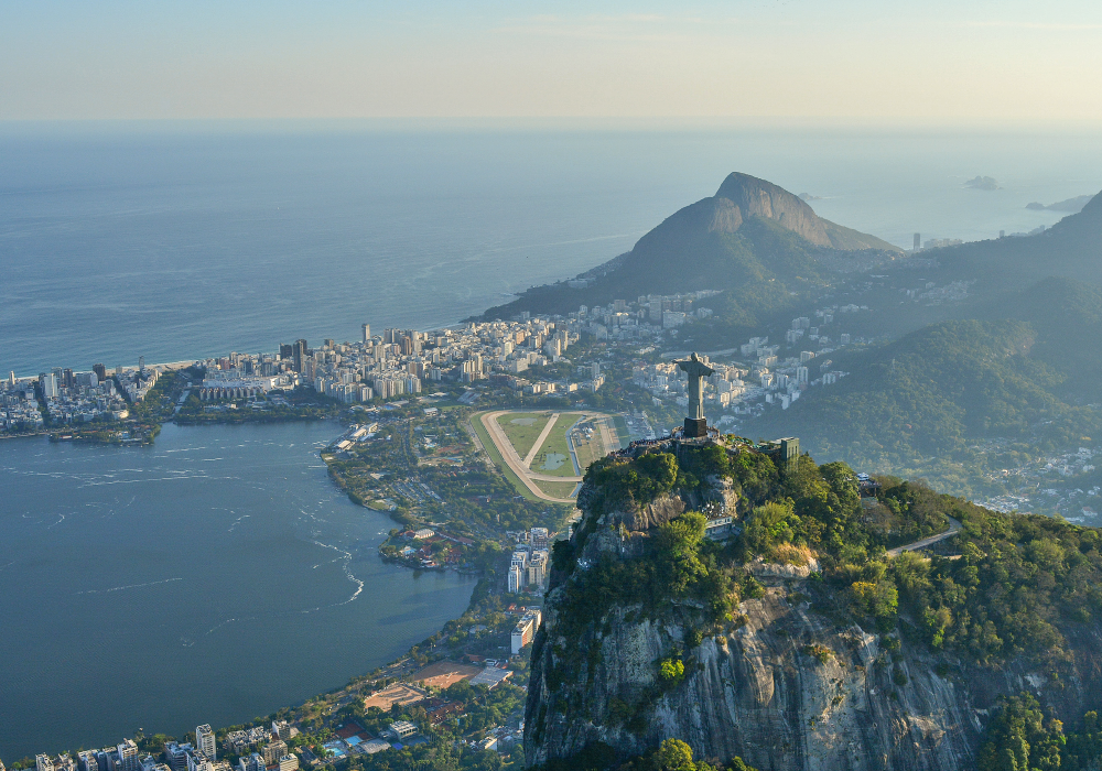 The best places to visit in Brazil - Shows Christ the Redeemer statue overlooking Rio de Janeiro city
