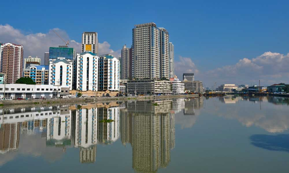One Life Adventures Philippines tour - Shows Manila skyline - skyscrapers alongside river