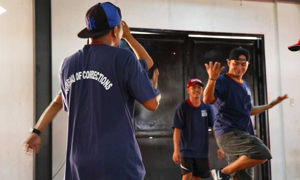One Life Adventures Philippines tour - Shows a group of dancing inmates from Iwahig Prison