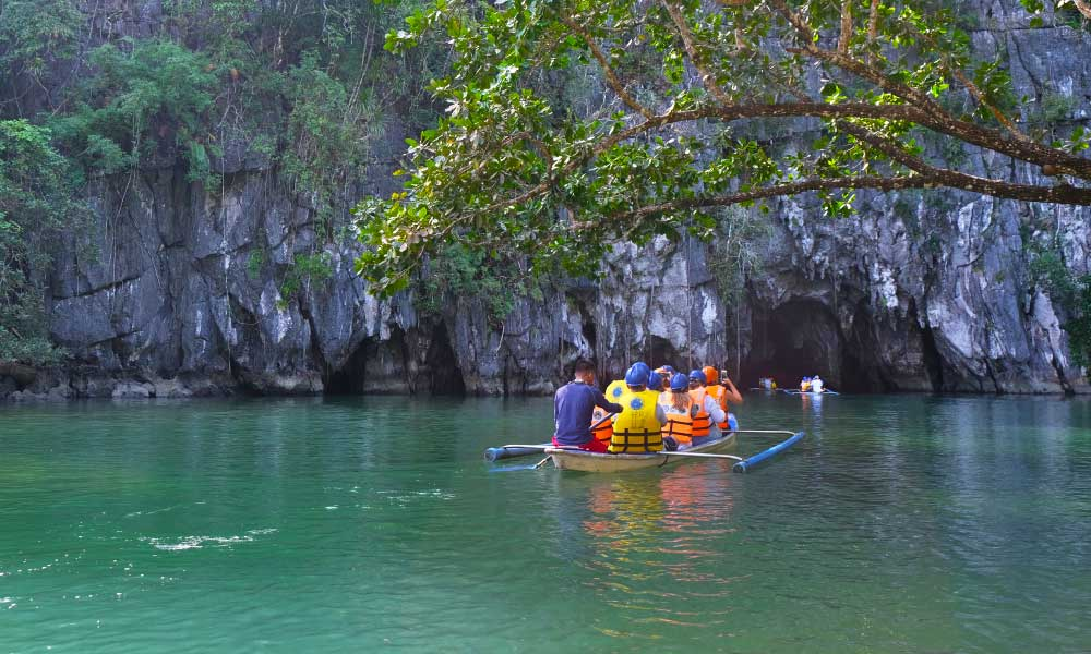 Shows a boat floating into the Puerto Princesa Underground caves