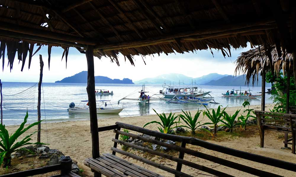 One Life Adventures Philippines tour - A picturesque view from wooden huts on a beach