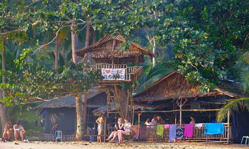 One Life Adventures Philippines tour - Shows the One Life tree house and tour group on the beach