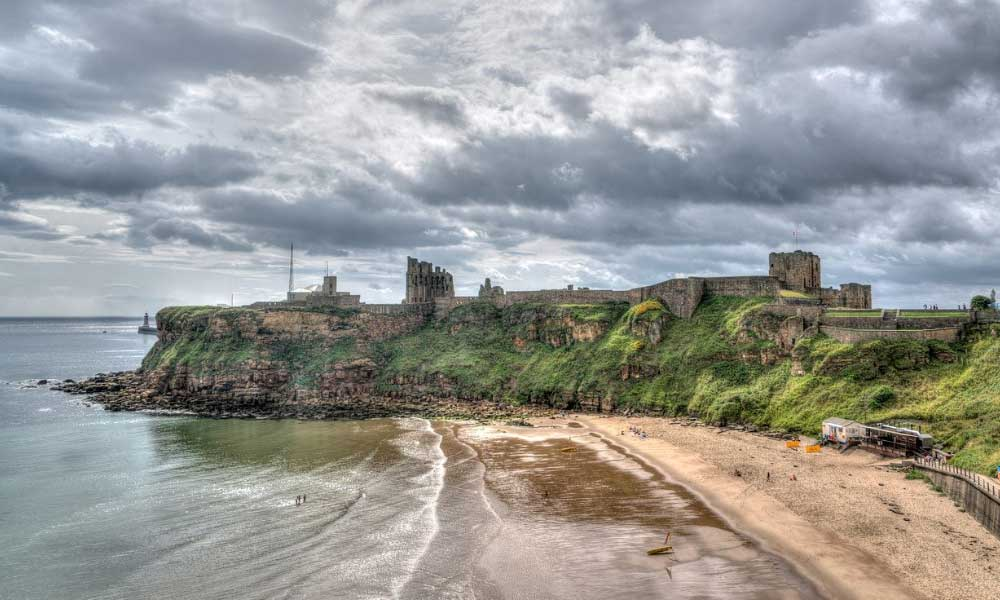 A view of Tynemouth Priory and beach