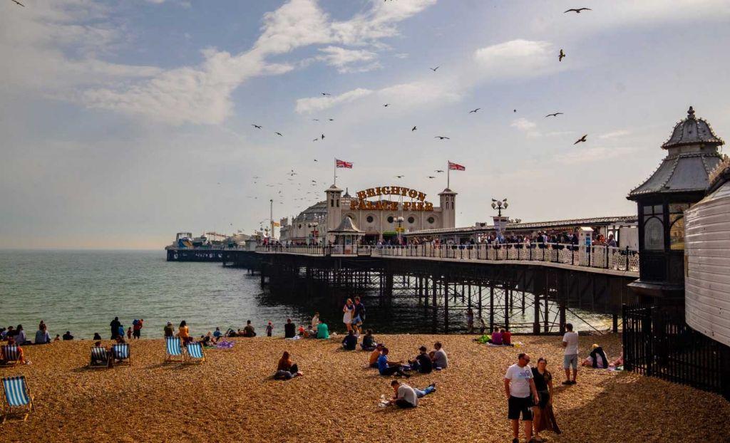 Shows Brighton Pier in the summer - UK weekend breaks