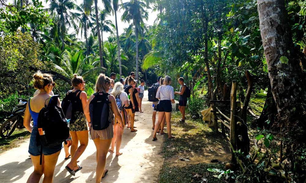 Tourists walking to the Philippines Experience