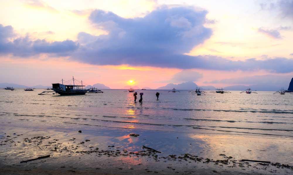 Shows Marimegmeg Beach at sunset