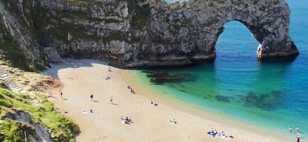 Where to go on holiday in the UK - Shows Durdle Door rock formation in Dorset