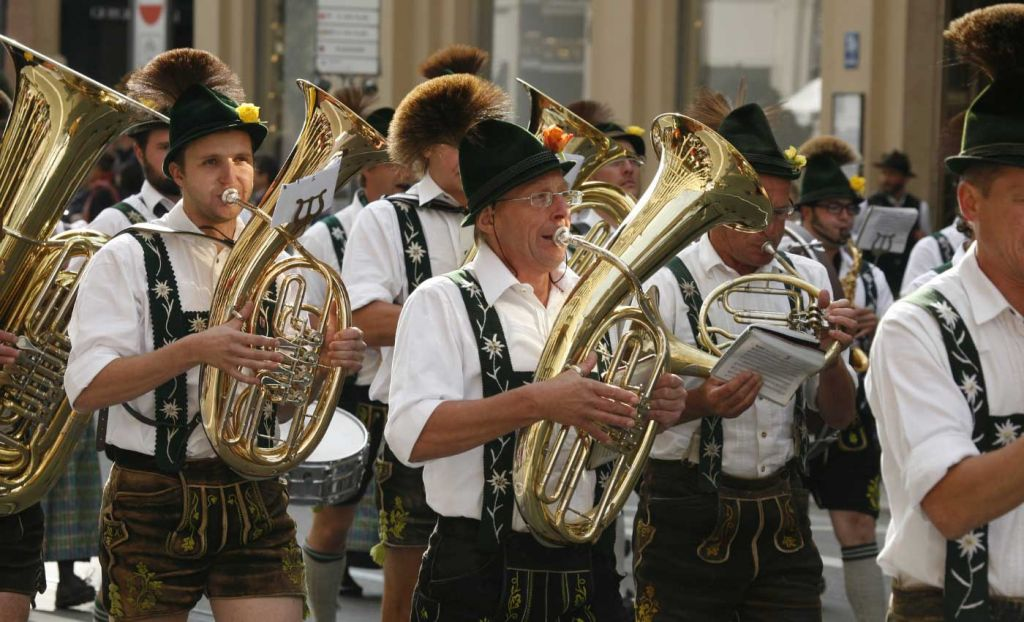 Shows a marching band at Oktoberfest in Germany