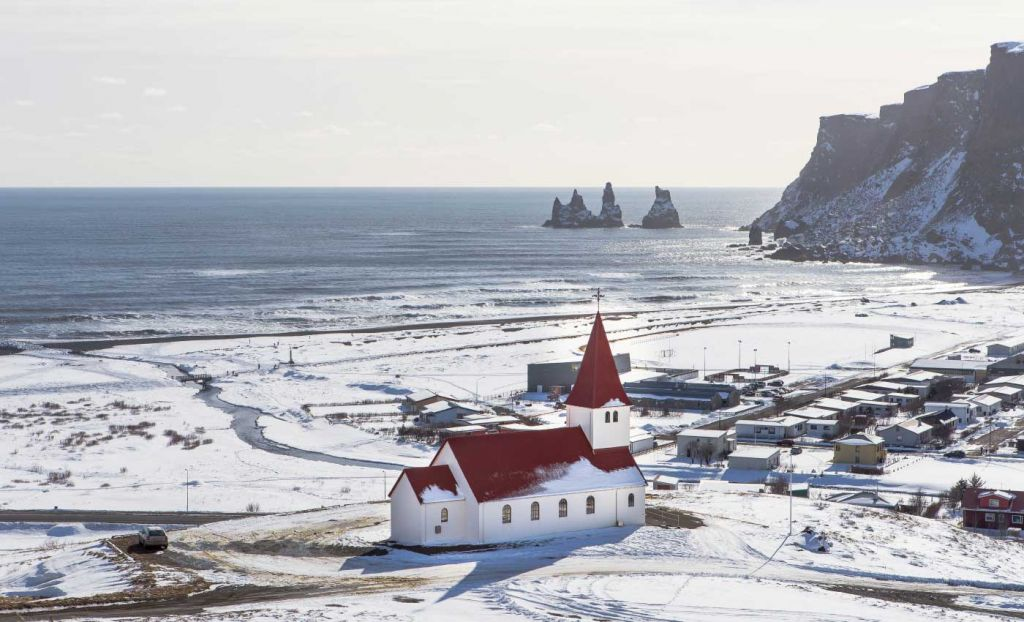 An Icelandic church amongst snowy landscape in Iceland