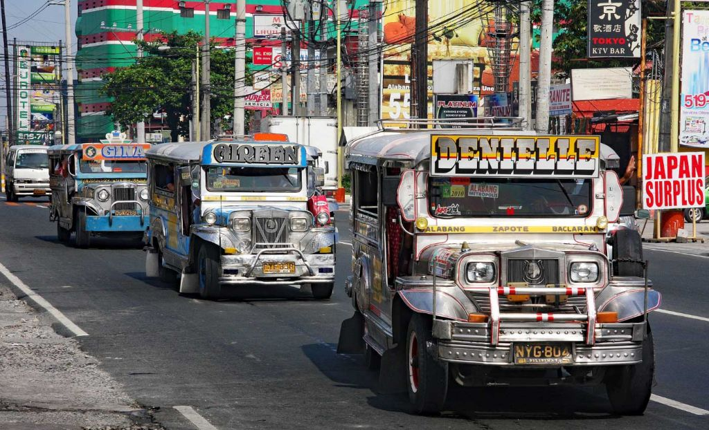 How to get from Manila Airport to the city - Shows a group of Jeepneys in traffic