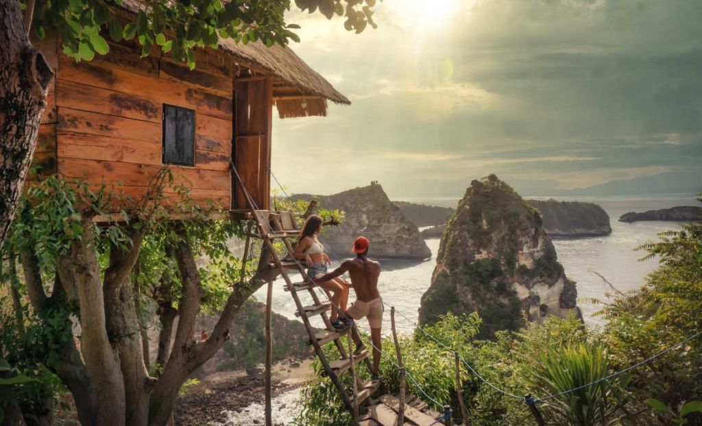 Romantic places to go on holiday - A couple overlooking the cliffs of Nusa Penida