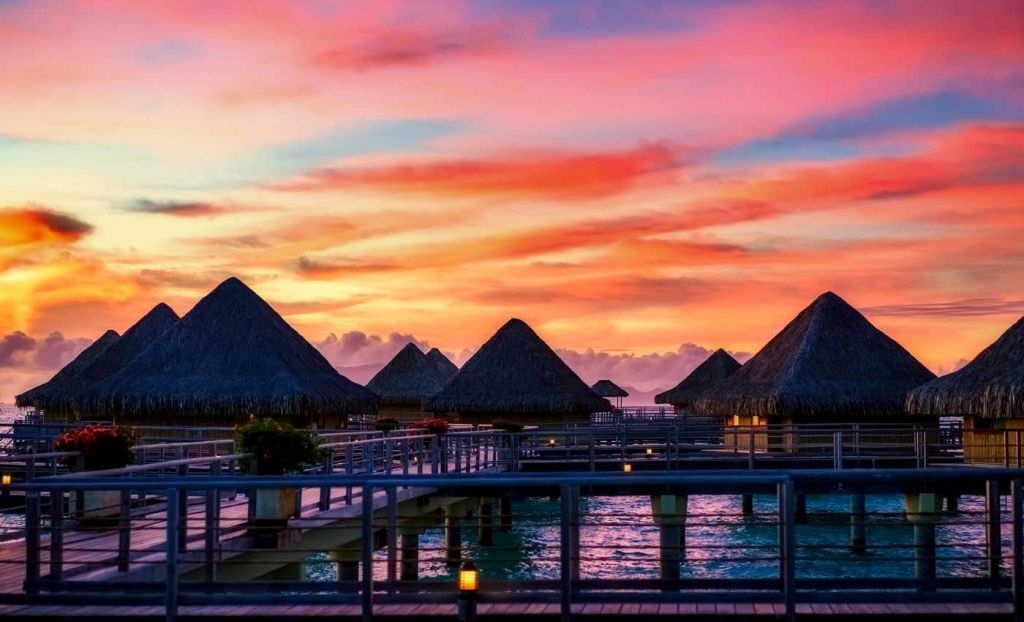 Romantic holiday destinations - Shows the luxury beach huts of Bora Bora