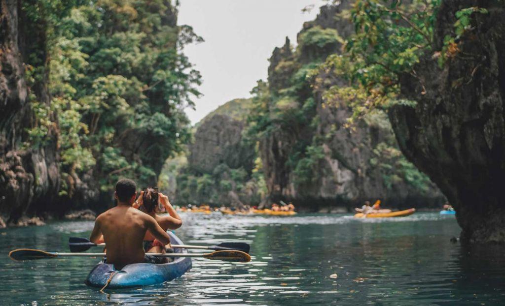 A couple kayaking in El Nido's Big Lagoon