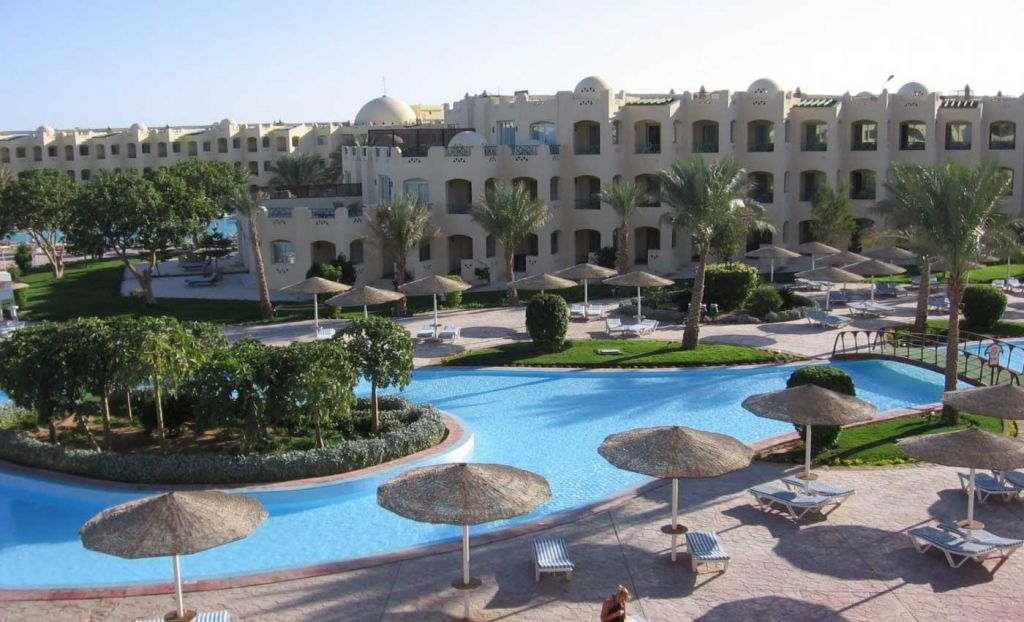 All inclusive holiday destinations - Pool and sun loungers by a traditional Egypt hotel