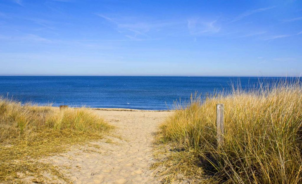 Cheap places to visit in the UK - Shows the sand dunes of the Norfolk Coast