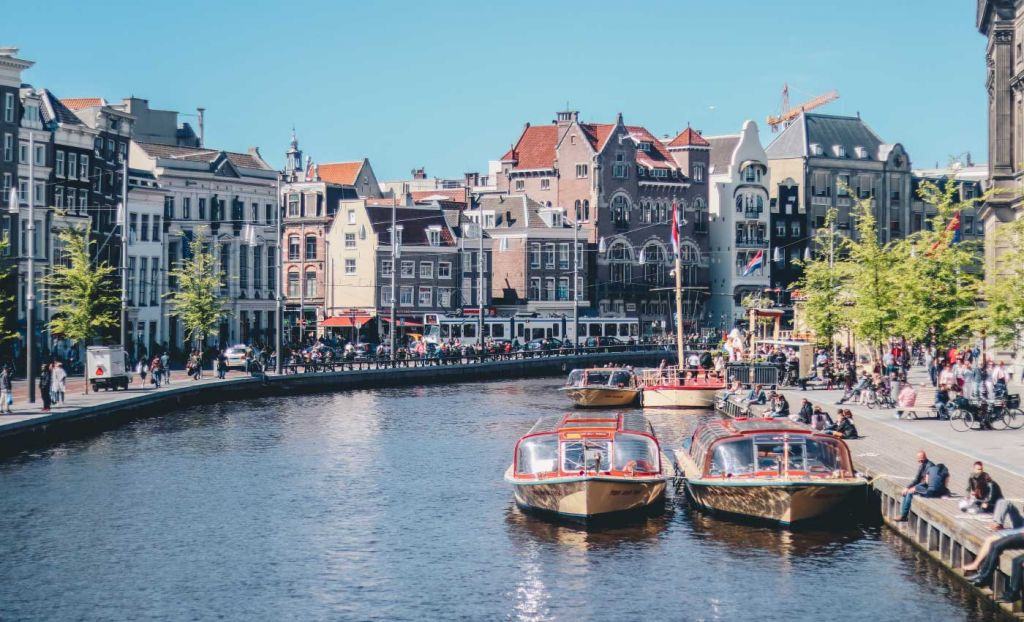 Europe day trips from London - Amsterdam boats on a canal