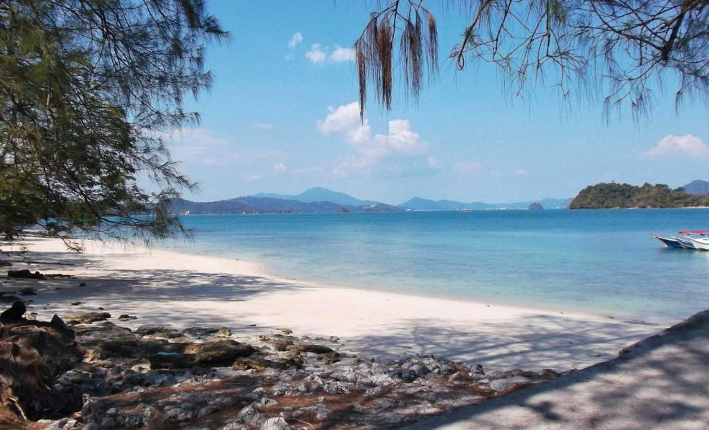 The best beaches in Langkawi - Shows a white-sand beach and blue ocean
