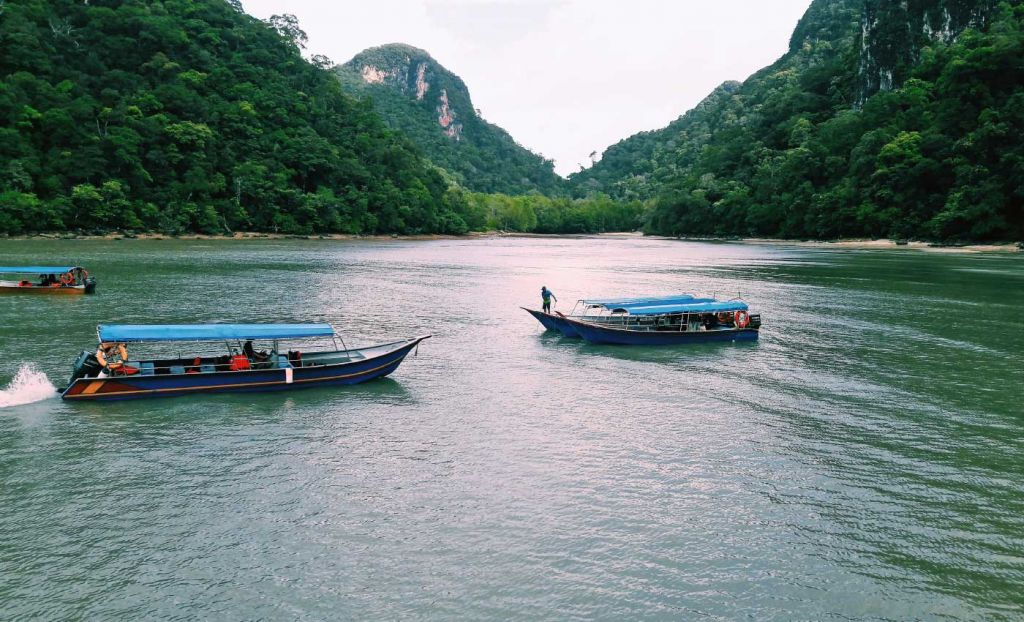 Boats floating near Kilim Karst Geoforest Park