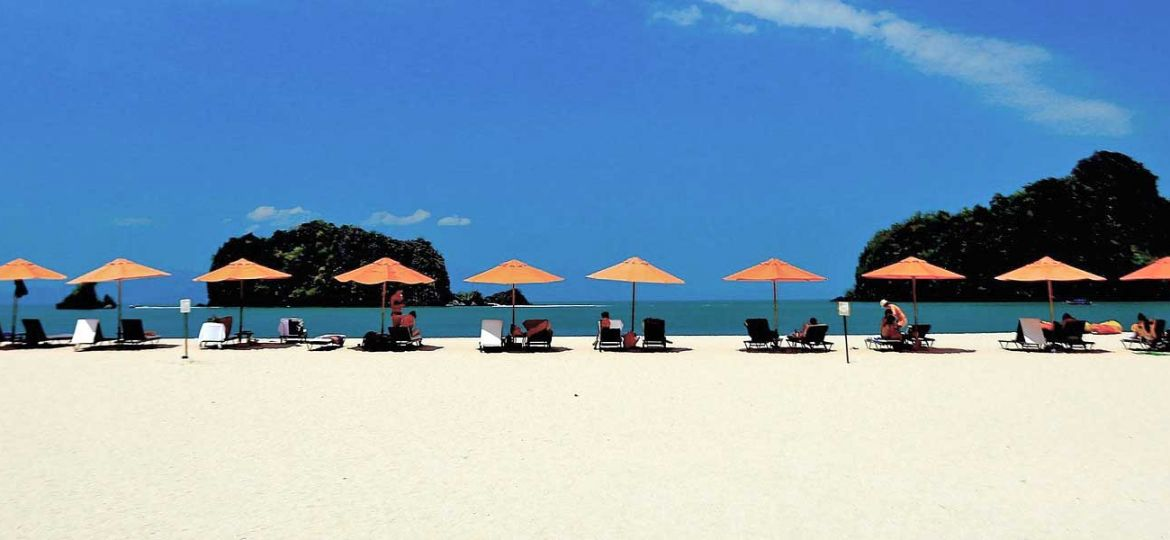 Best things to do in Langkawi - Shows a white sand beach with sun loungers