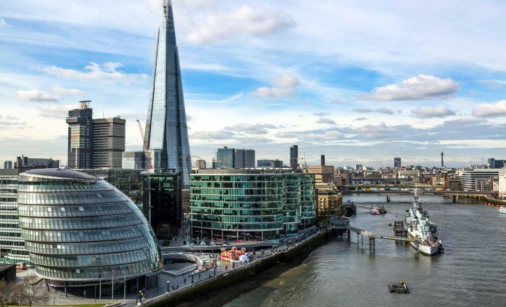 3 week UK itinerary - Shows the Shard on the River Thames in London