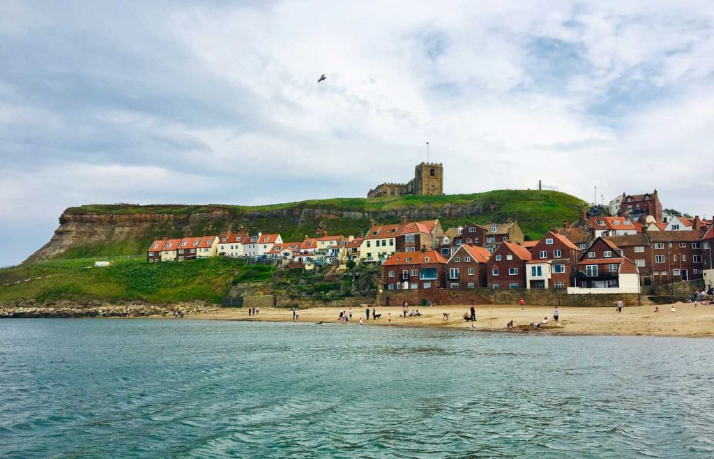 Best places to visit in Yorkshire - Shows Whitby town beach