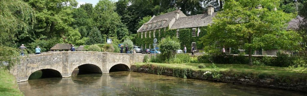 Places to visit in the Cotswolds - Shows a quaint village and bridge