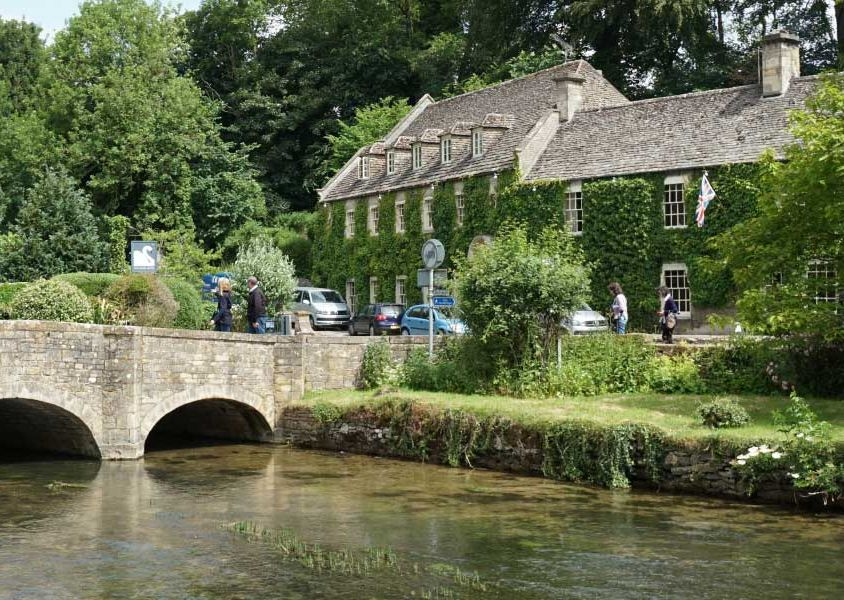 Places to visit in the Cotswolds - Shows a quaint village and bridge