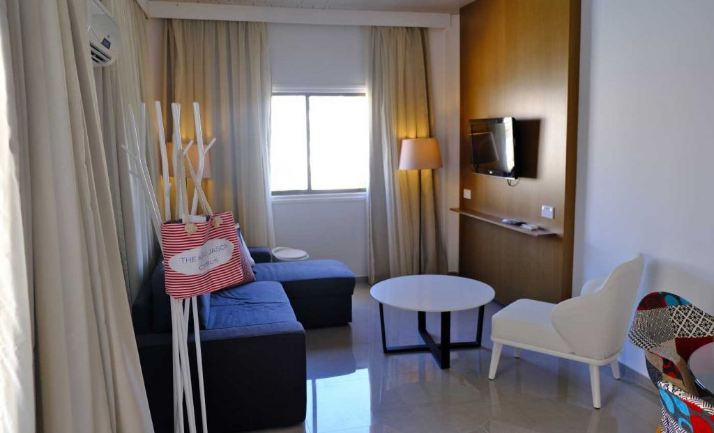 The King Jason Paphos Hotel review - living room of a one bed suite