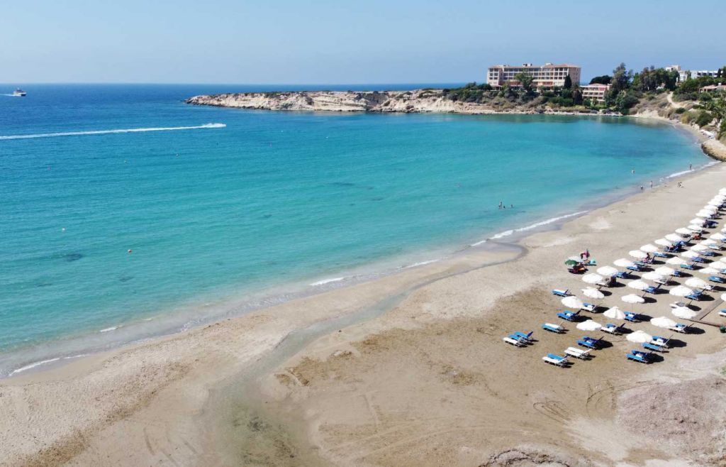 Overhead drone shot of Coral Bay beach - Paphos beaches