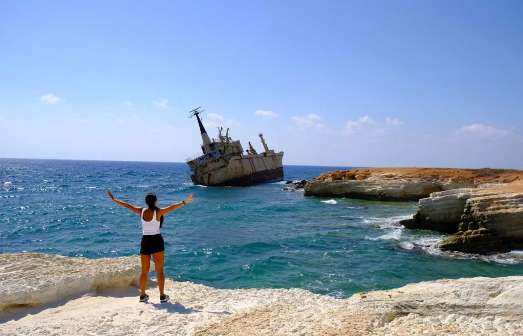 The best holidays for young couples - Susie overlooking a shipwreck in Paphos
