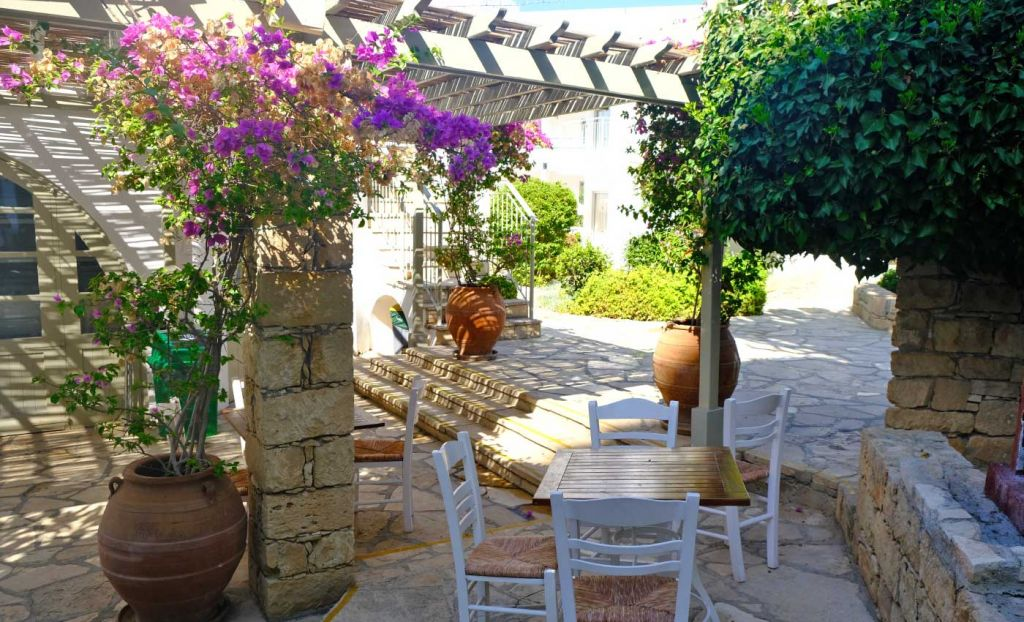 Garden seating area of the Greek Taverna restaurant