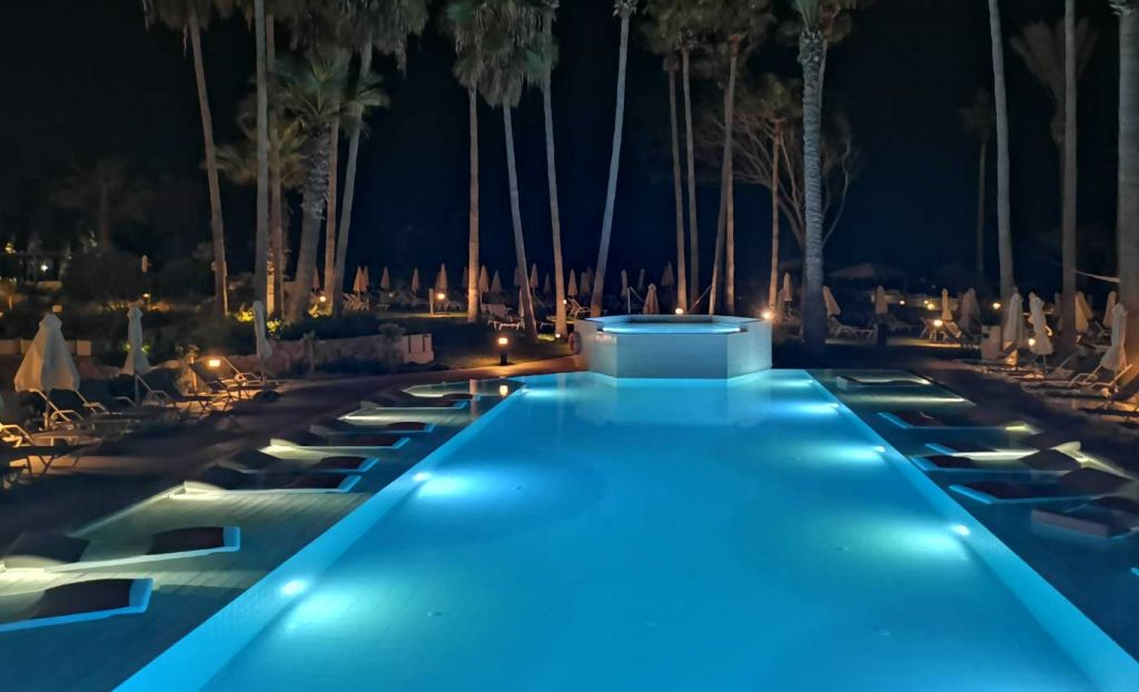 Shows the main swimming pool at night
