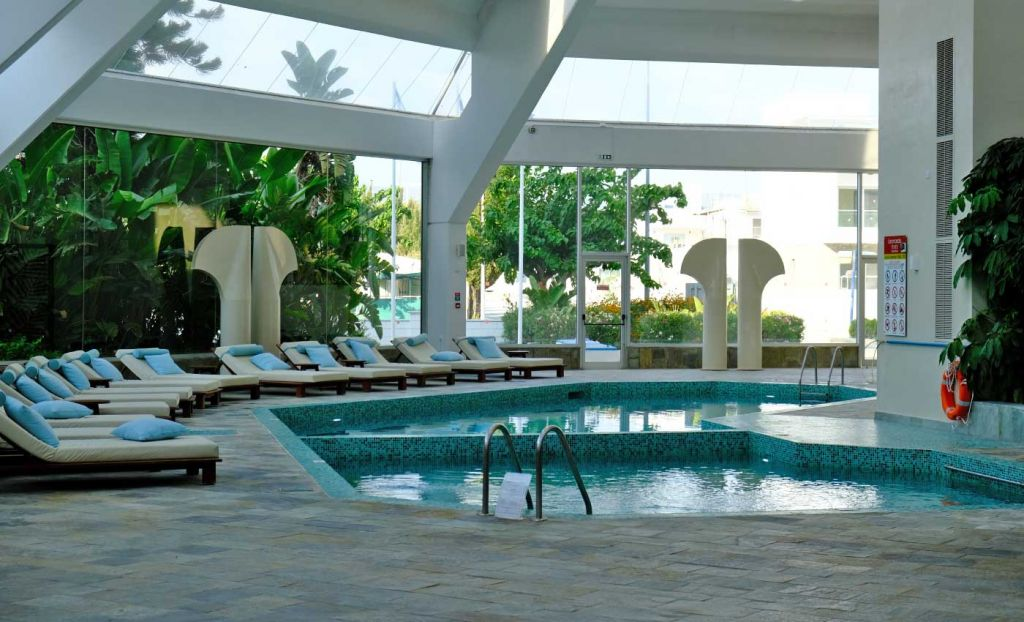 Shows the indoor pool and spa area