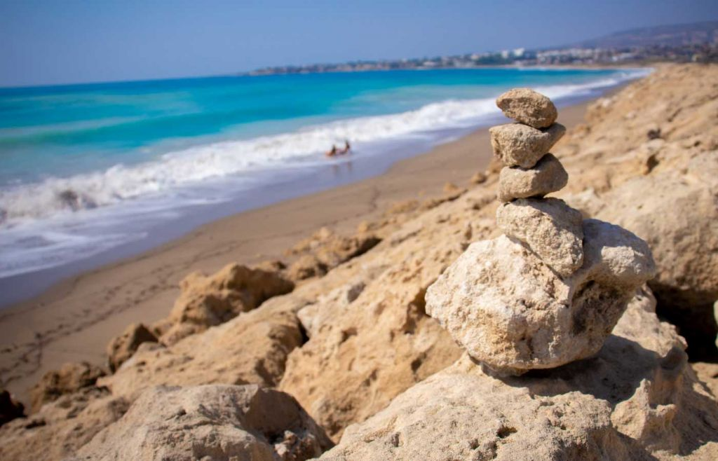 Paphos travel tips - Shows rocks on a beach