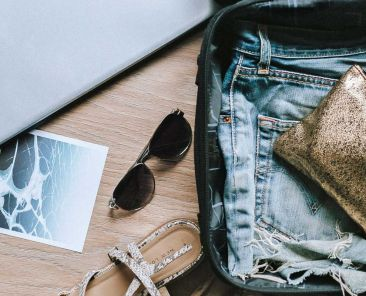 Best travel essentials for women - Shows holiday suitcase
