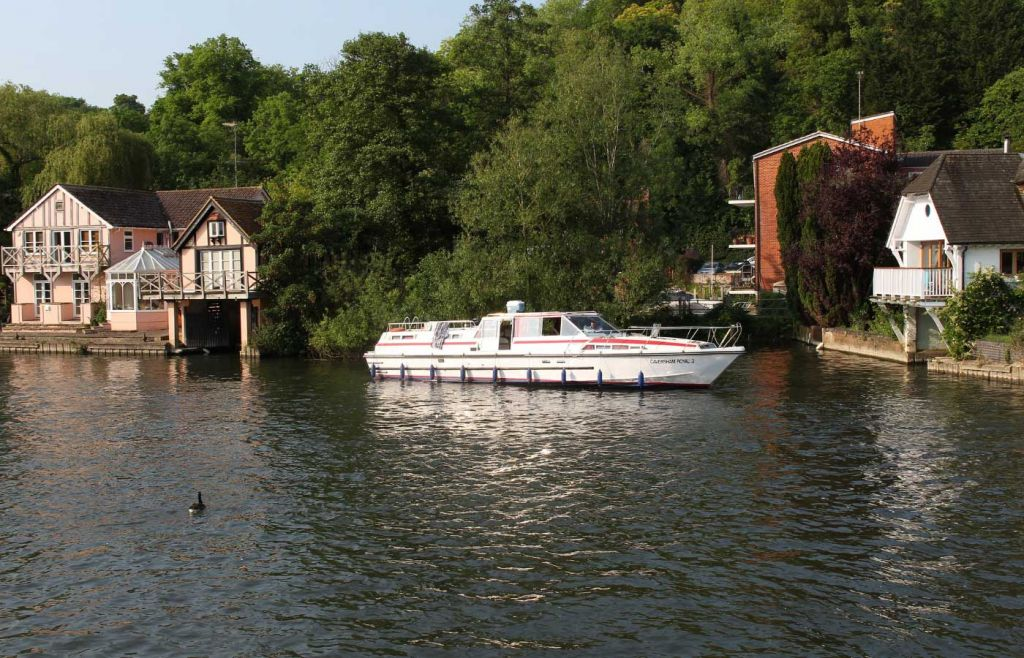 River houses and a boat in Henley on Thames