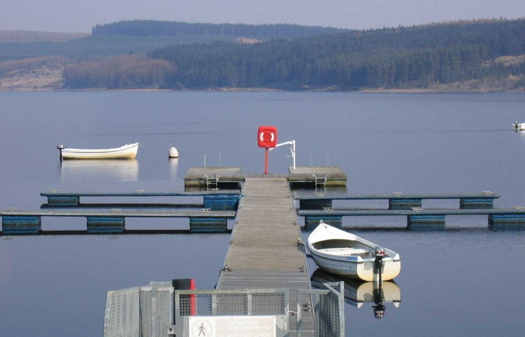 Best places to visit in Northumberland - Shows a tranquil pier at Kielder Lake