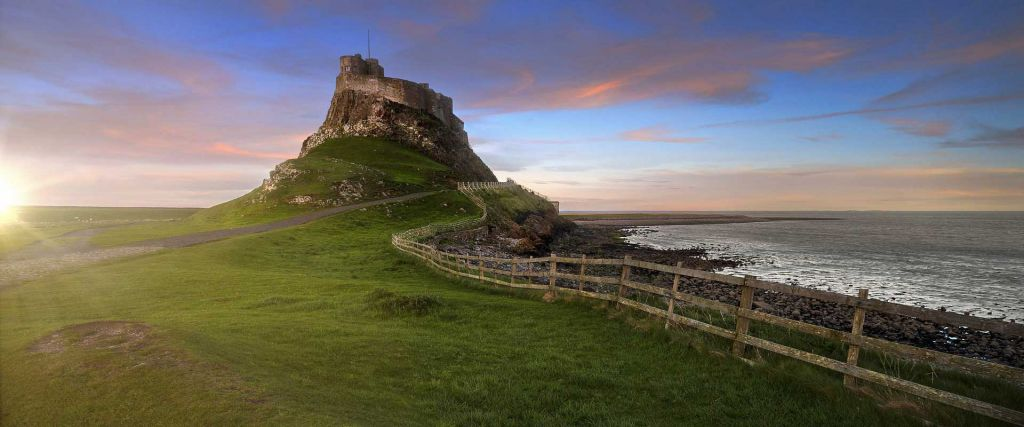 The best places to visit in Northumberland - Shows the abbey on Holy Island
