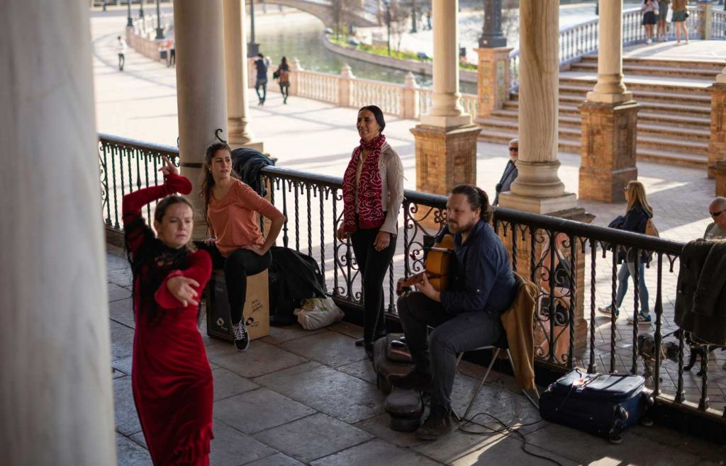 Spanish dancer and musicians in Seville square