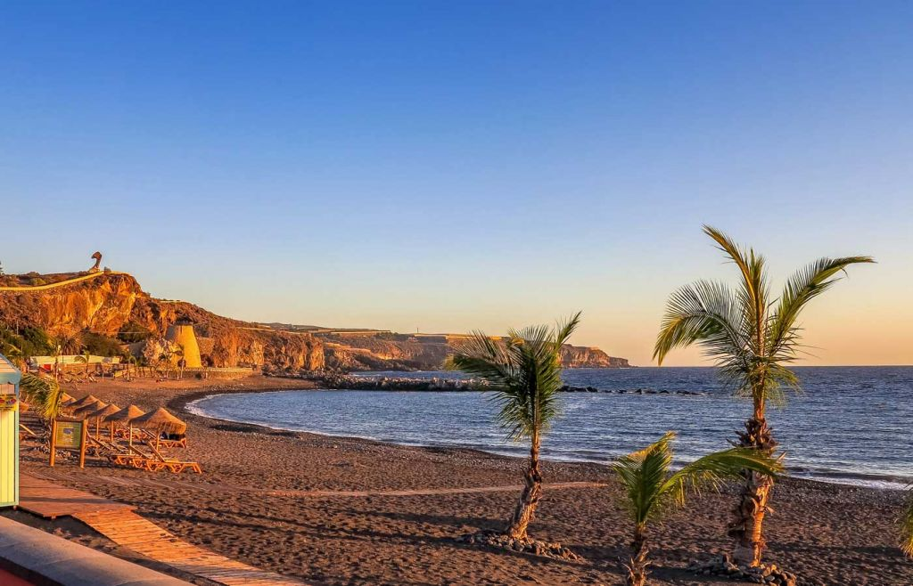 2021 holiday ideas - Golden sand beach in Tenerife at sunset
