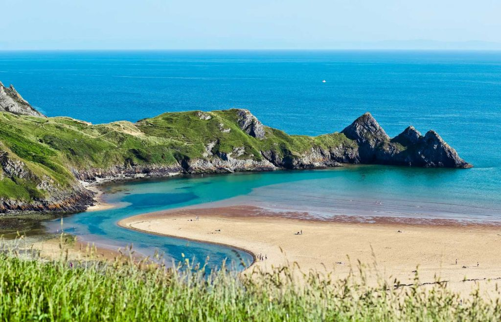 Shows a beautiful beach cove in Wales