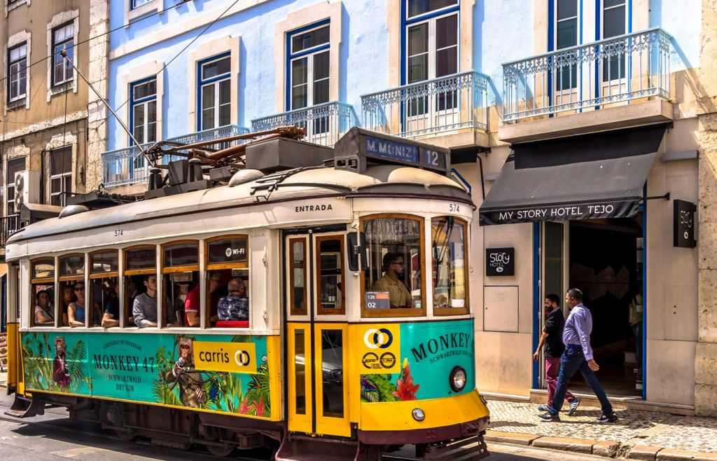 The best holiday destinations for young couples - Tram in Lisbon