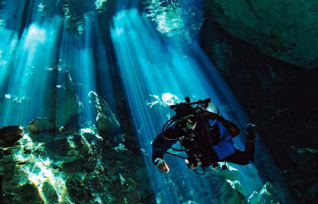 Shows a diver in a Mexican Cenote