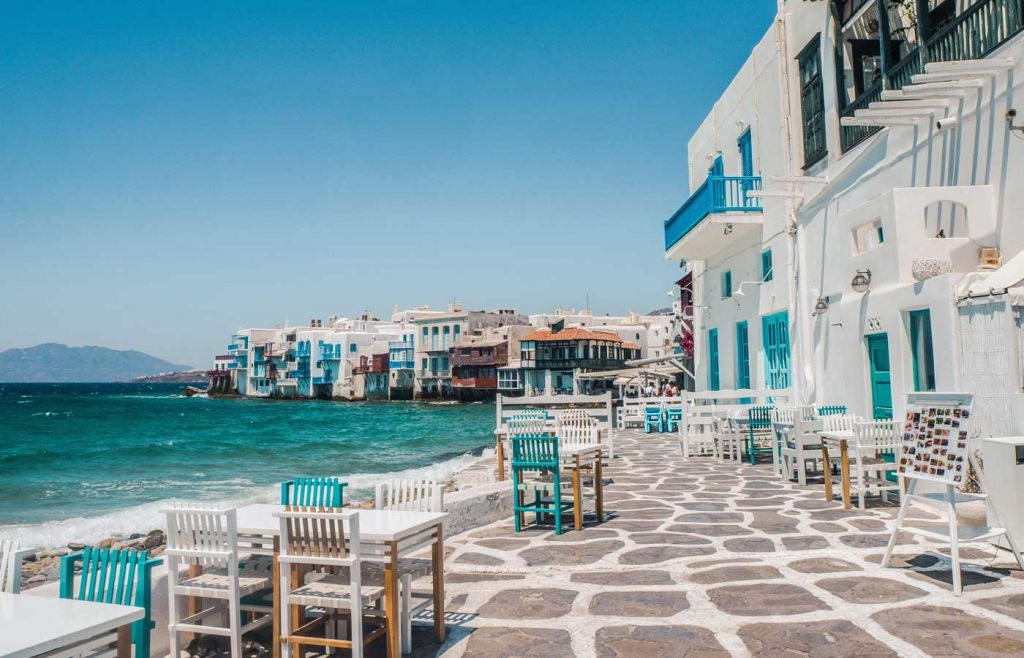 The best holidays for young couples - White buildings overlooking the ocean in Mykonos